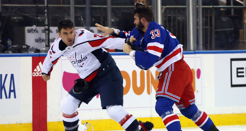 The Rangers' Phillip Di Guiseppe fights the Capitals' Garnet Hathaway.