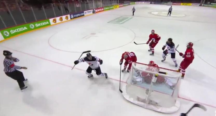Andrew Mangiapane scoring for Canada against Russia.