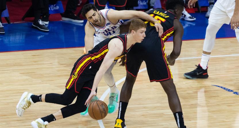 The Hawks' Kevin Huerter drives against the Sixers' Furkan Korkmaz.