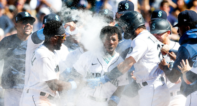 Shed Long Jr. mobbed by teammates after a walk-off grand slam.