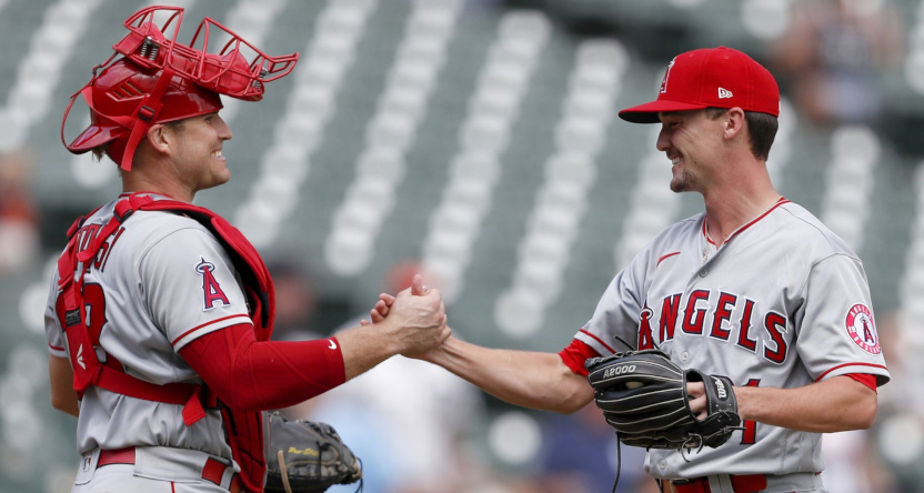 Max Stassi (L) and Austin Warren celebrated an Angels' comeback against the Tigers.