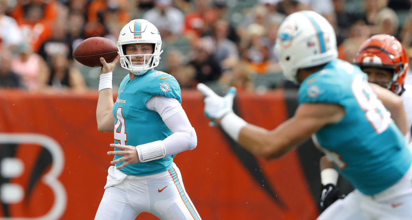 Reid Sinnett of the Dolphins throws a pass in a preseason game against the Bengals.