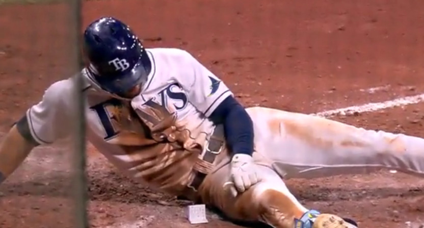 Kevin Kiermaier picking up a card.