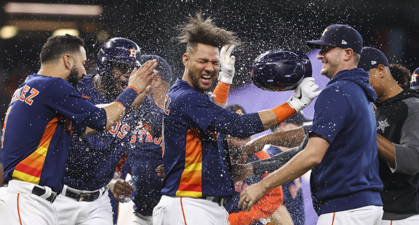 Yuli Gurriel (center) and teammates celebrating a Game 162 win against the Oakland A's.