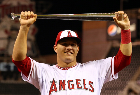 MINNEAPOLIS, MN - JULY 15:  American League All-Star Mike Trout #27 of the Los Angeles Angels poses with the MVP trophy after a 5-3 victory over the National League All-Stars during the 85th MLB All-Star Game at Target Field on July 15, 2014 in Minneapolis, Minnesota.  (Photo by Elsa/Getty Images)