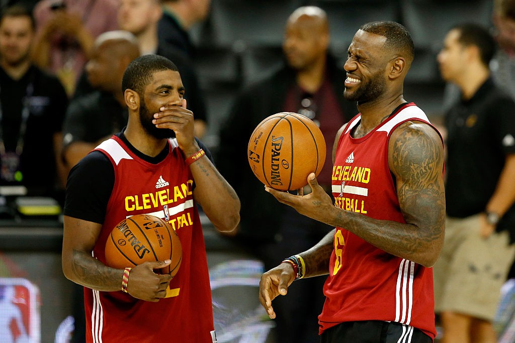 OAKLAND, CA - JUNE 01:  LeBron James #23 and Kyrie Irving #2 of the Cleveland Cavaliers laugh during a conversation at practice for the 2016 NBA Finals at ORACLE Arena on June 1, 2016 in Oakland, California. The Warriors will take on the Cavaliers on June 2, 2016. (Photo by Ezra Shaw/Getty Images)