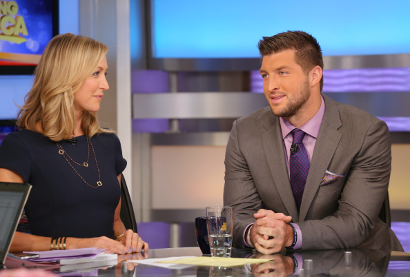 GOOD MORNING AMERICA - ESPN and SEC Network Analyst Tim Tebow has joined GOOD MORNING AMERICA as a contributor, 9/15/14.   GMA airs Monday  Friday (7-9am, ET) on the ABC Television Network.  (Photo by Fred Lee/ABC via Getty Images)
