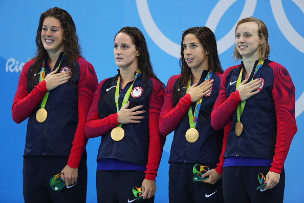 RIO DE JANEIRO, BRAZIL - AUGUST 10:  Gold medalists Allison Schmitt, Leah Smith, Maya Dirado and Katie Ledecky of the United States pose on the podium during the medal ceremony for the Women's 4 x 200m Freestyle Relay Final on Day 5 of the Rio 2016 Olympic Games at the Olympic Aquatics Stadium on August 10, 2016 in Rio de Janeiro, Brazil.  (Photo by Tom Pennington/Getty Images)