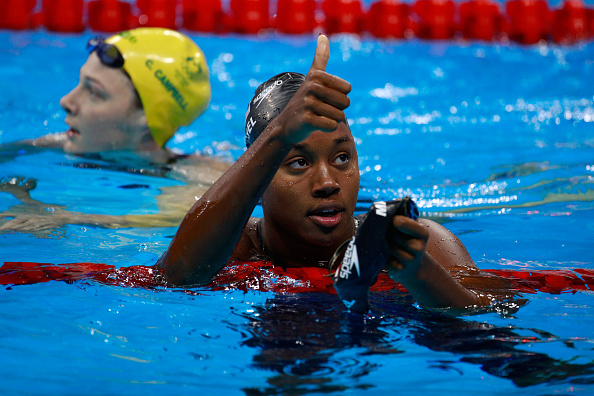 RIO DE JANEIRO, BRAZIL - AUGUST 12:  Simone Manuel of the United States celebrates in the second Semifinal of the Women's 50m Freestyle on Day 7 of the Rio 2016 Olympic Games at the Olympic Aquatics Stadium on August 12, 2016 in Rio de Janeiro, Brazil.  (Photo by Adam Pretty/Getty Images)