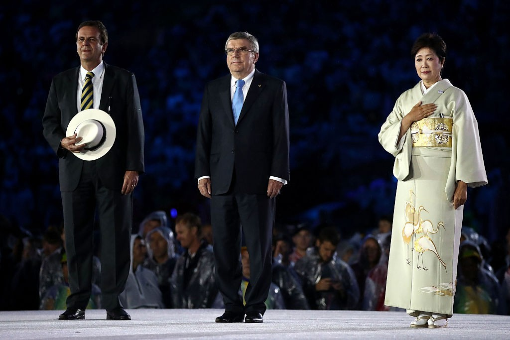 RIO DE JANEIRO, BRAZIL - AUGUST 21:  Mayor of Rio de Janeiro Eduardo Paes, IOC President Thomas Bach and Governor of Tokyo Yuriko Koike take part in the Flag Handover Ceremony during the Closing Ceremony on Day 16 of the Rio 2016 Olympic Games at Maracana Stadium on August 21, 2016 in Rio de Janeiro, Brazil.  (Photo by Cameron Spencer/Getty Images)