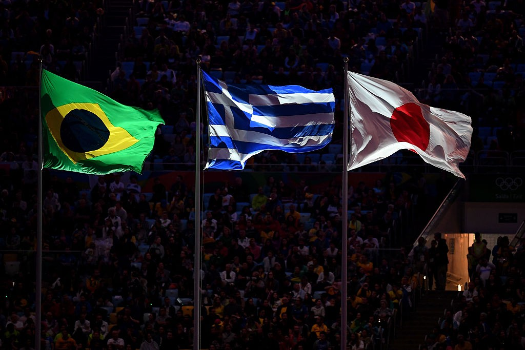 RIO DE JANEIRO, BRAZIL - AUGUST 21: The flags of Brazil, Greece and Japan are seen during the Closing Ceremony on Day 16 of the Rio 2016 Olympic Games at Maracana Stadium on August 21, 2016 in Rio de Janeiro, Brazil.  (Photo by David Ramos/Getty Images)