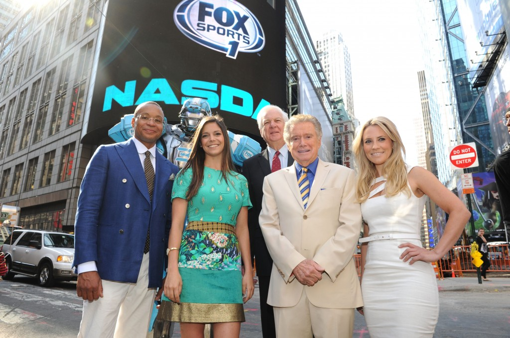 NEW YORK, NY - AUGUST 16:  Gus Johnson, Cleatus the Robot, Georgie Thompson, Bill Raftery, Regis Philbin and Katie Nolan ring the opening bell at the NASDAQ MarketSite on August 16, 2013 in New York City.  (Photo by Craig Barritt/Getty Images)