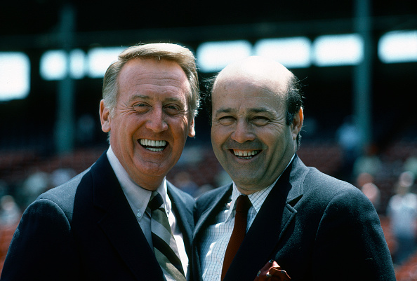 UNSPECIFIED - CIRCA 1983:  NBC sport personalities Vince Scully (L) and Joe Garagiola (R) poses together for this photo prior to the start of a Major League Baseball game circa 1983. (Photo by Focus on Sport/Getty Images)