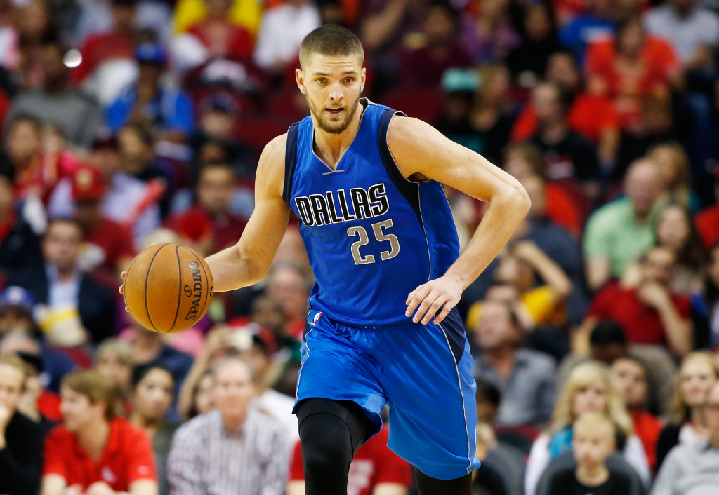 HOUSTON, TX - NOVEMBER 22:  Chandler Parsons #25 of the Dallas Mavericks brings the basketball upcourt during their game against the Houston Rockets at the Toyota Center on November 22, 2014 in Houston, Texas.  NOTE TO USER: User expressly acknowledges and agrees that, by downloading and/or using this photograph, user is consenting to the terms and conditions of the Getty Images License Agreement.  (Photo by Scott Halleran/Getty Images)