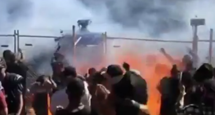 Burning fuel from this car doing burnouts in Australia Sunday hit spectators, injuring 12.