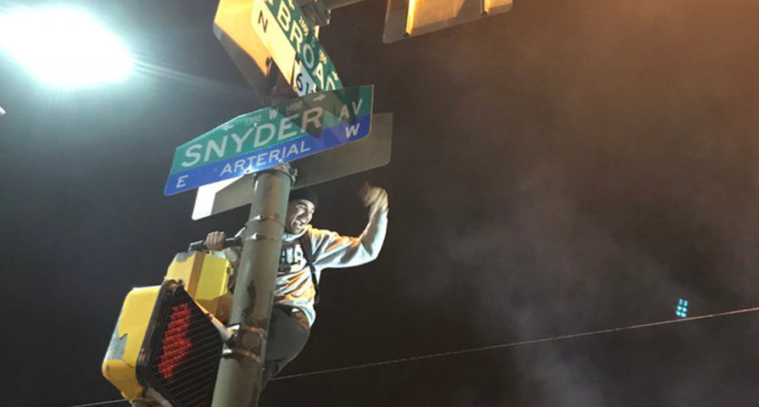 Post-game celebrations in Philly included this fan climbing a pole.