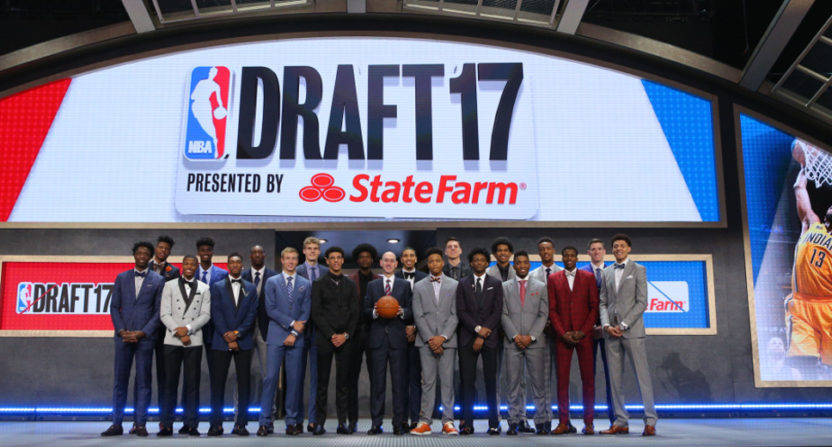 Adam Silver with the 2017 NBA draft's first-round picks.