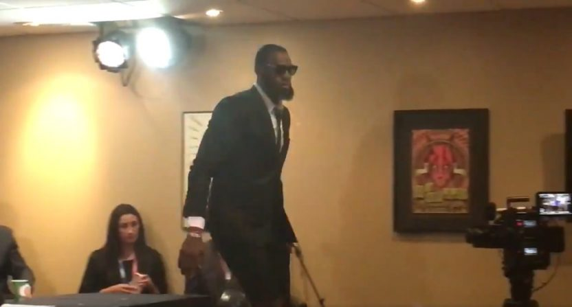 LeBron leaves a press conference after Mark Schwarz's repeated questions about J.R. Smith.