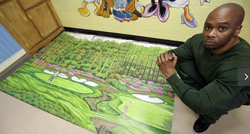 Valentino Dixon with one of his golf drawings.