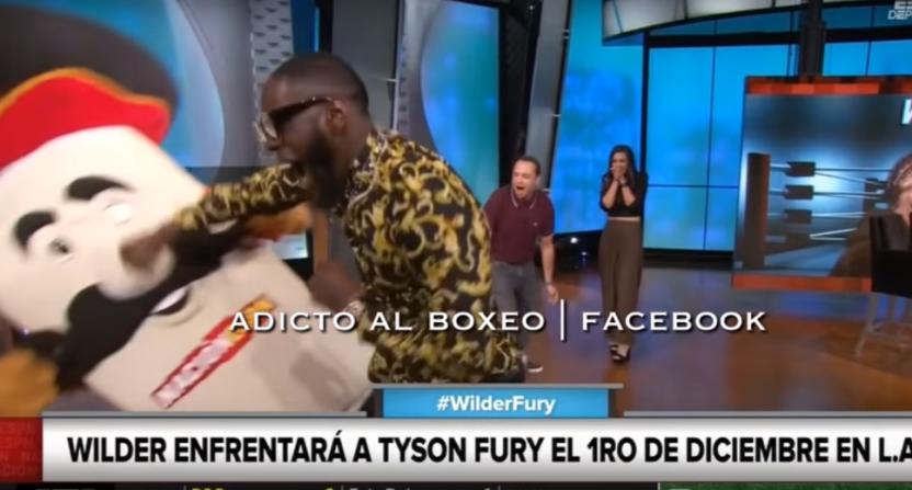 Deontay Wilder punching a mascot.