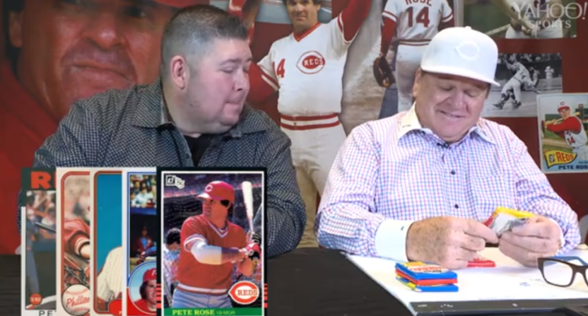 Yahoo's Mike Oz opening old baseball cards with Pete Rose.