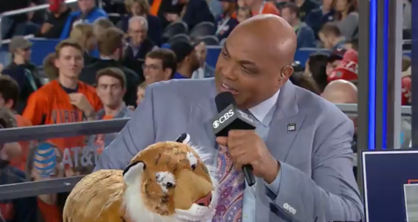 Charles Barkley at the Final Four with a stuffed tiger.