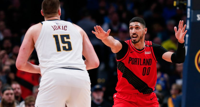 Enes Kanter defends against Nikola Jokic.