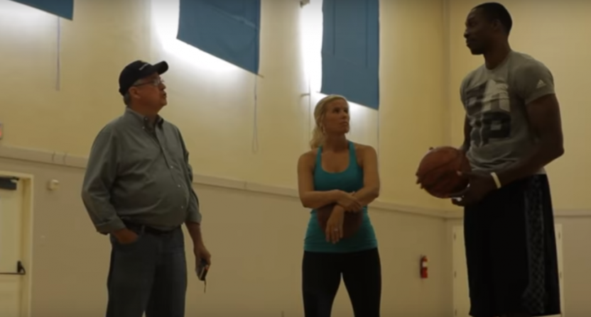 T.J. Simers, his daughter, and Dwight Howard in a 2013 video.