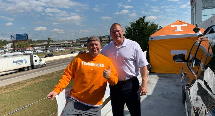 Knoxville radio host Tyler Ivens (L) on a Toyota dealership roof with Glenn Jacobs.