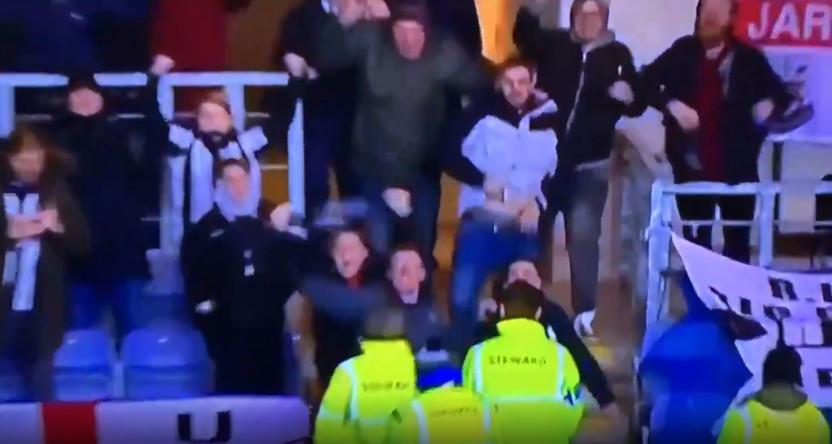 A Newcastle United fan exposing himself.