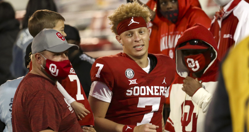 Oklahoma QB Spencer Rattler with fans after a Nov. 21 game against Kansas.