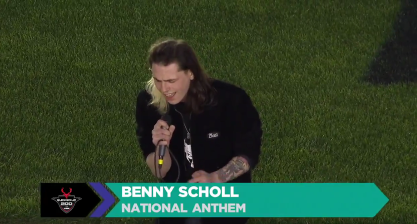 Benny Scholl performs the national anthem at a NASCAR Truck Series race in Las Vegas.