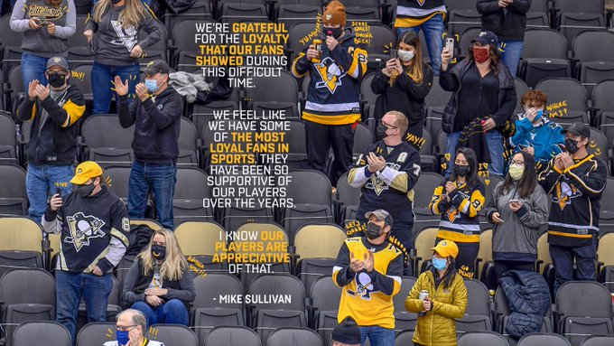 A photo of Penguins' fans altered to show them wearing masks.
