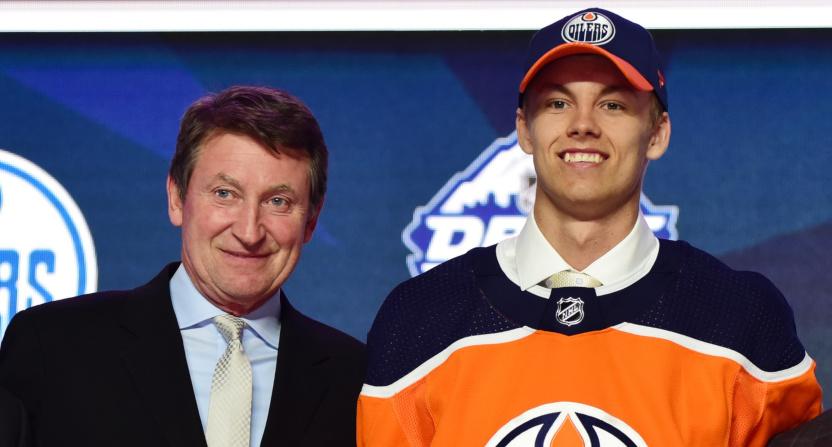 Wayne Gretzky with Oilers' draft pick Philip Broberg in June 2019.