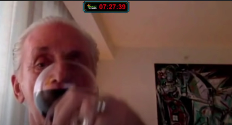 Pat Riley drinking wine during an interview with Dan Le Batard.