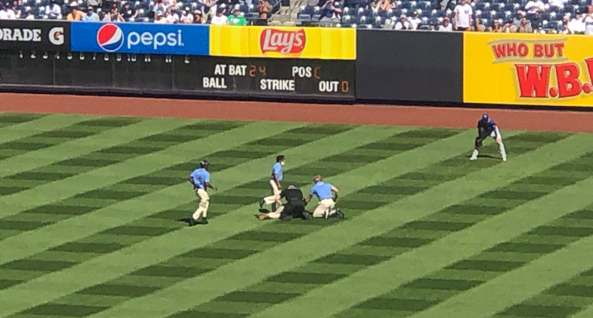Bryan Hoch's photo of a fan on the field at Yankee Stadium.