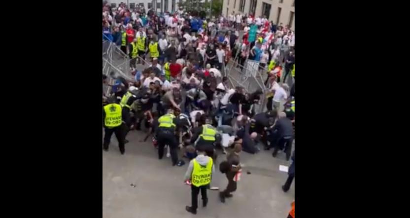 Fans breaking through Wembley barricades around the Euro 2020 final.