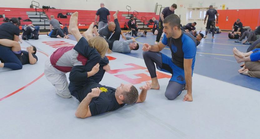 Rener Gracie instructing police in Brazilian jiu jitsu.