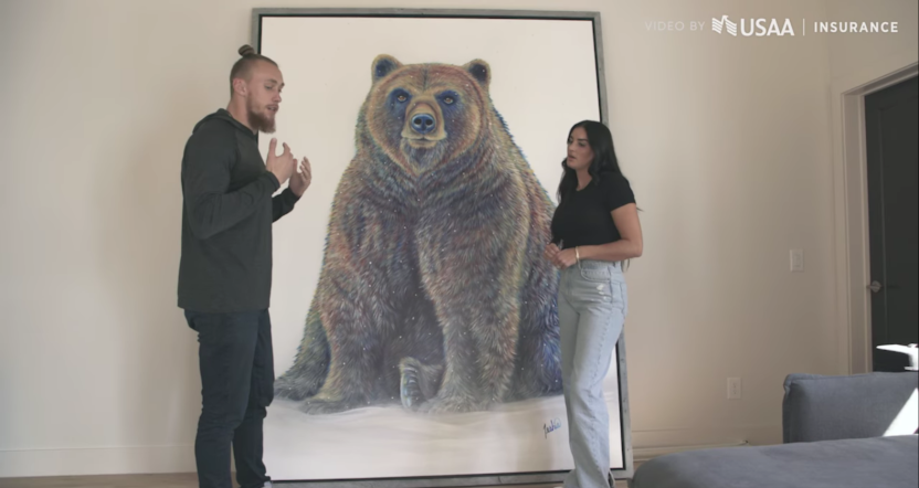 George Kittle with his bear painting.
