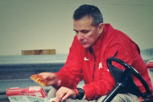 Urban Meyer eating sad pizza after a 2013 loss.